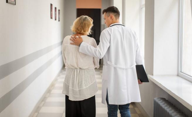 back-view-doctor-senior-woman-walking